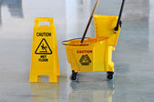 Mop, Bucket and Caution Wet Floor — Stock Photo