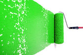 Roller With Green Paint on White Wall — Stock Photo