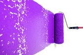 Roller With Purple Paint on White Wall — Stock Photo