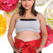 Pregnant Woman With Red Ribbon - Stock Photo