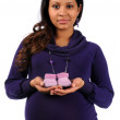 Young Mother Holding Knitted Baby Shoes — Stock Photo