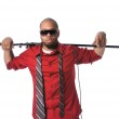 Man With Microphone Stand on Shoulder — Stock Photo #14567497