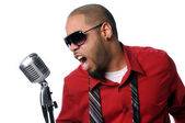 Young Man Singing Into Vintage Microphone — Stock Photo