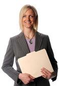 Empresária segurando arquivo sorrindo — Foto Stock