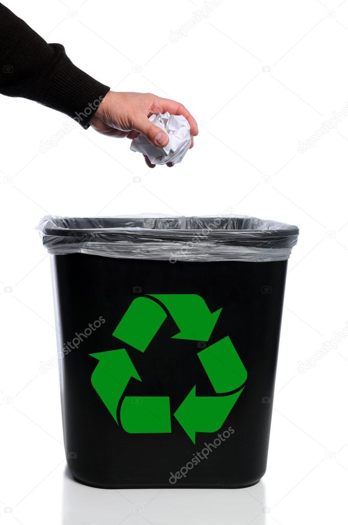 Man's hand placing paper in trash can with recycle symbol — Stock Photo #14567193