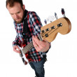 Stock Photo: Guitar Player From High Angle