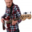 Man Playing Bass Guitar - Stock Photo