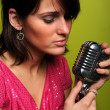 Woman Singing into Vintage Microphone — Stock Photo