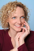 Woman Smiling With Hand on Face — Stock Photo