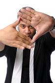 Man med händerna som ram — Stockfoto