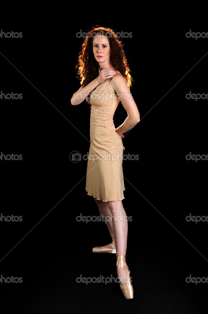 Beautiful ballet dancer posing over a black background — Stock Photo #14766615