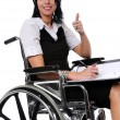 Stock Photo: Womon Wheelchair Expressing Positivity