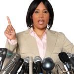 Woman Speaking Behind Microphones — Stock Photo