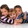 Stock Photo: Children Embracing Laying on the Floor