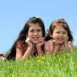Young Girls Laying on Grass — Stockfoto