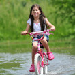 Royalty-Free Stock Photo: Young Girl Riding Bicycle