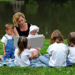 Woman Reading to Children — Stock Photo