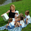 Mother Reading To Children — Stock Photo #15393593