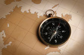 Compass on a Vintage Map — Stock Photo