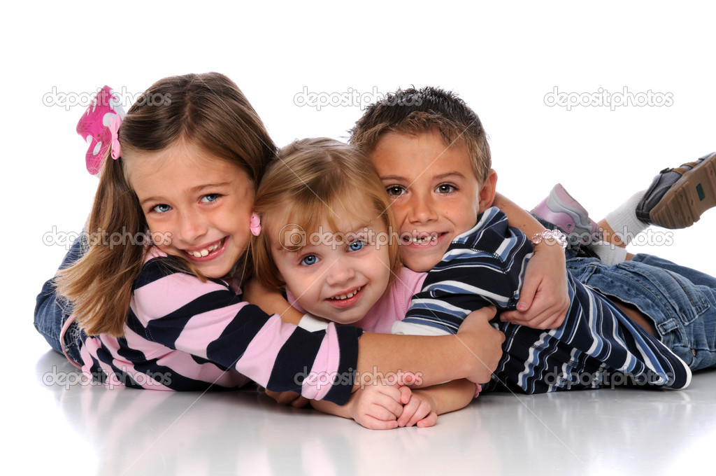 Children embracing laying on the floor over a white background — Stock Photo #15391481