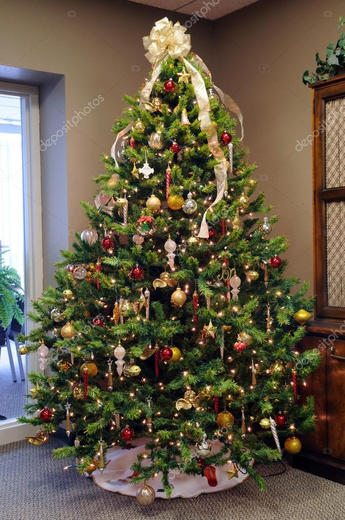 Christmas tree with ornaments in a corner of room — Stock Photo #15816061
