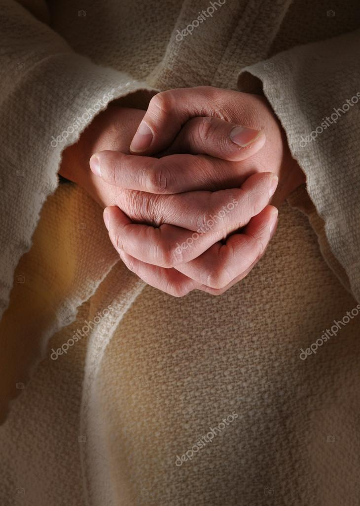 The hands of Jesus in clasped in prayer  Stock Photo #15816951