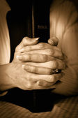 Bible and Hands — Stock Photo