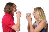 Couple Using Tin Can Phone to scream — Stock Photo