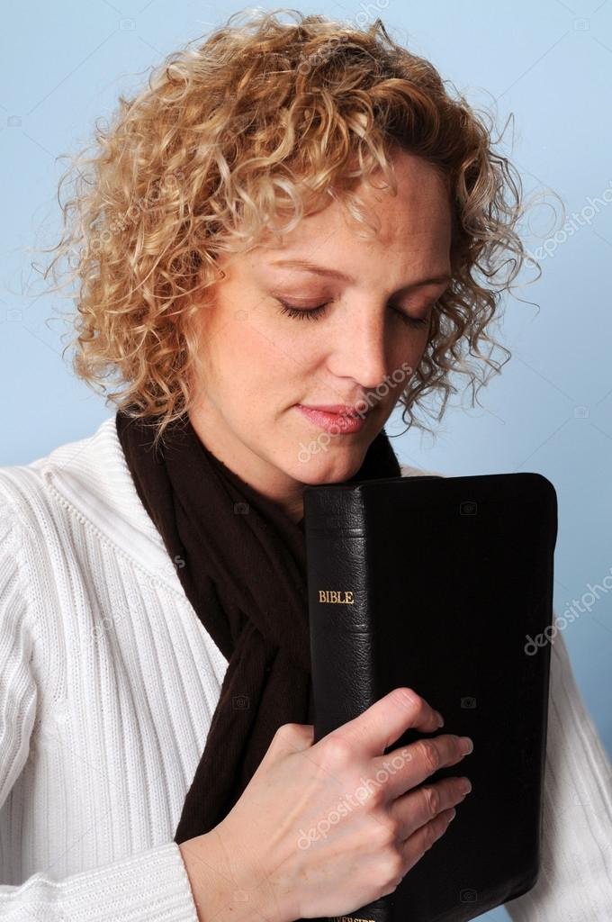 Young woman praying holding a Bible — Stock Photo #15820267