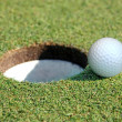 Golf Ball Going in the Hole — Photo