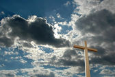 Cross against Bright Clouds — Stock Photo