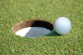 Golf Ball Going in the Hole — Stock Photo