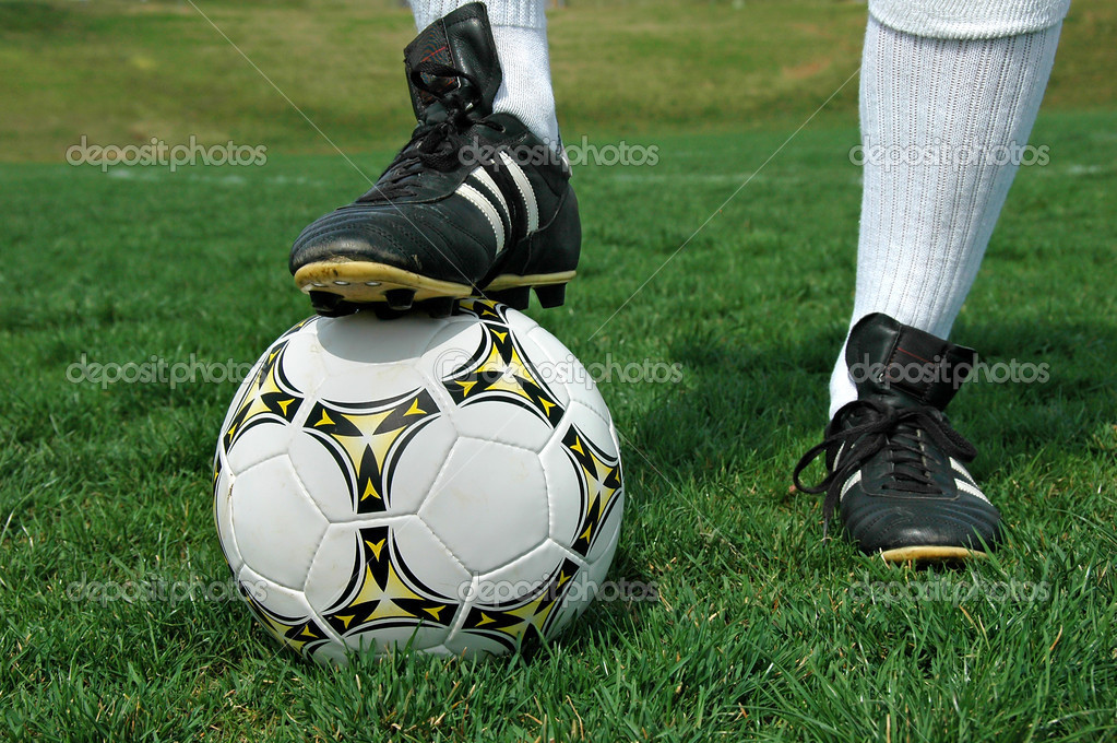 Soccer ball under shoe of player — Stock Photo #16856167