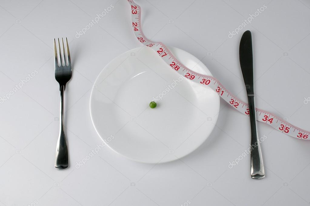 Extreme diet with pea and tape measure — Stock Photo #16856497