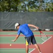 Mature Man Playing Tennis - Stok fotoğraf