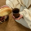 Jesus Hands Holding Bread and Wine - Foto Stock