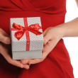 Woman's Hands Holding Gift — Stock Photo