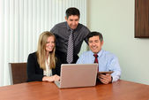 Coworkers Sharing Information on Laptop — Stock Photo