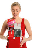 Young Woman With Pile of Gifts — Stock Photo