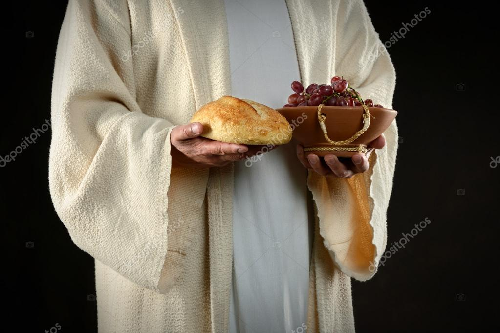 Jesus hands holding bread and grapes, symbols of communion  Stock Photo #18415051