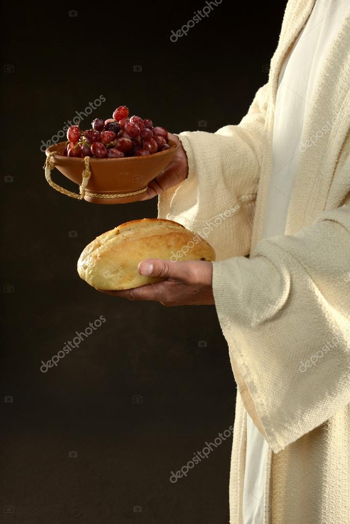 Jesus holding bread and grapes symbols of communion — Stock Photo #18415293