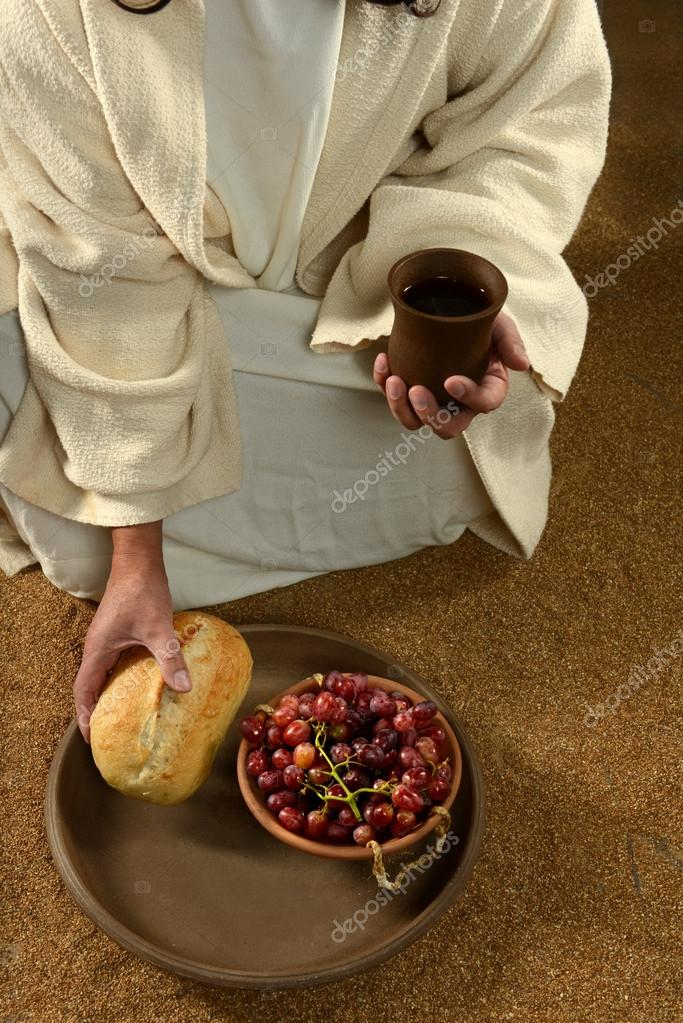 Jesus hands holding communion symbols: bread and wine — Stock Photo #18415319