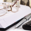Datebook, glasses, calculator, pen and dollar note — Stock Photo