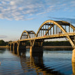 Stock Photo: River bridge in evening sunbeam