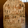 Ancient stone carved egyptian hieroglyphics in museum — Stock Photo