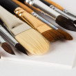 Artist brushes on sketchbook sheets — Stockfoto
