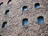 Wall of ancient castle with windows — Stock Photo
