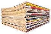 Pile of old magazines isolated on white background — Stock Photo
