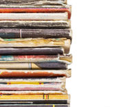 End of pile of old magazines isolated on white background — Stock Photo