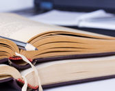 Close-up view of gray pencil lying on two opened old books — Stock Photo
